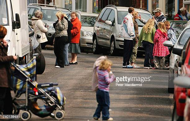 Residents stand in the street after an earth quake caused damage to houses on April 28, 2007 in Folkstone, Kent. The earth quake, with a magnitude of...