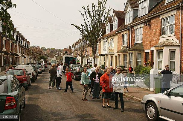 Residents stand in the street after an earthquake caused damage to houses on April 28, 2007 in Folkstone, Kent. The earth quake, with a magnitude of...