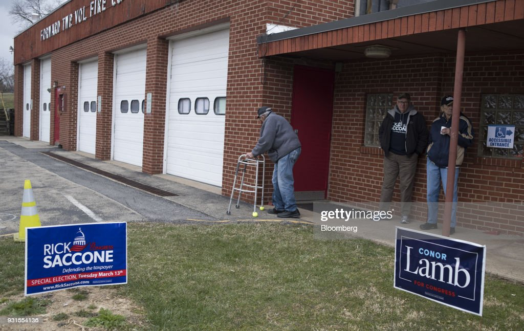 Residents stand outside the Forward Township Volunteer Fire Department polling location in Forward Township, Pennsylvania, U.S., on March 13, 2018. Democrat Conor Lamb and Republican Rick Saccone are competing in the 18th District, where President Donald Trump won by almost 20 points in the 2016 presidential election, to replace Republican Tim Murphy who resigned last October amid personal scandal. Photographer: Ty Wright/Bloomberg via Getty Images