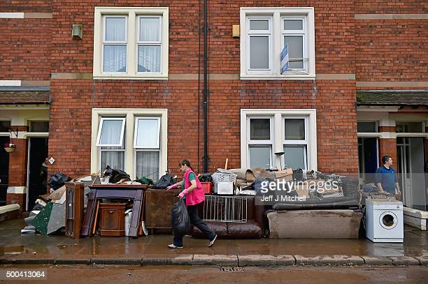 Residents start to empty their possessions from their homes after Storm Desmond caused flooding on December 8 2015 in Carlisle England Engineers are...