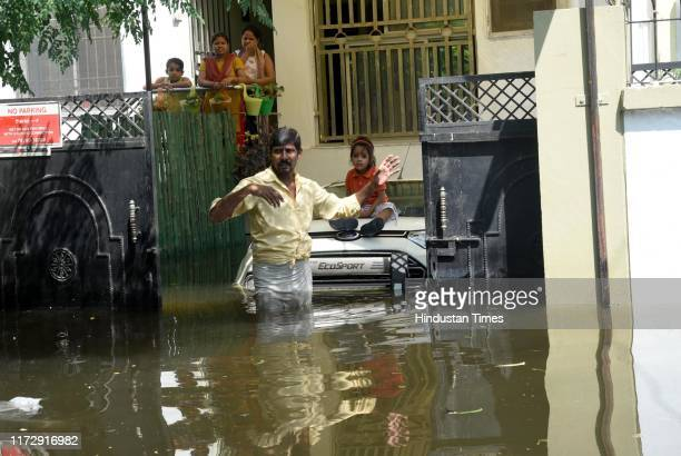 Residents stranded in the waterlogged area of Bahadurpur on October 1 2019 in Patna India At least 28 people have so far lost their lives in Bihar...