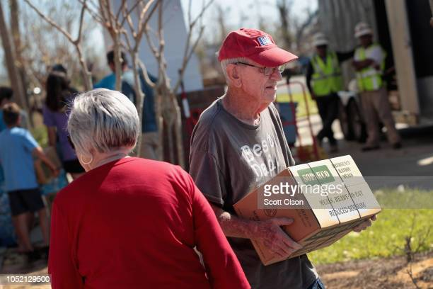 Residents struggling in the aftermath of Hurricane Michael get relief supplies at the Hiland Park Baptist Church on October 14 2018 in Panama City...