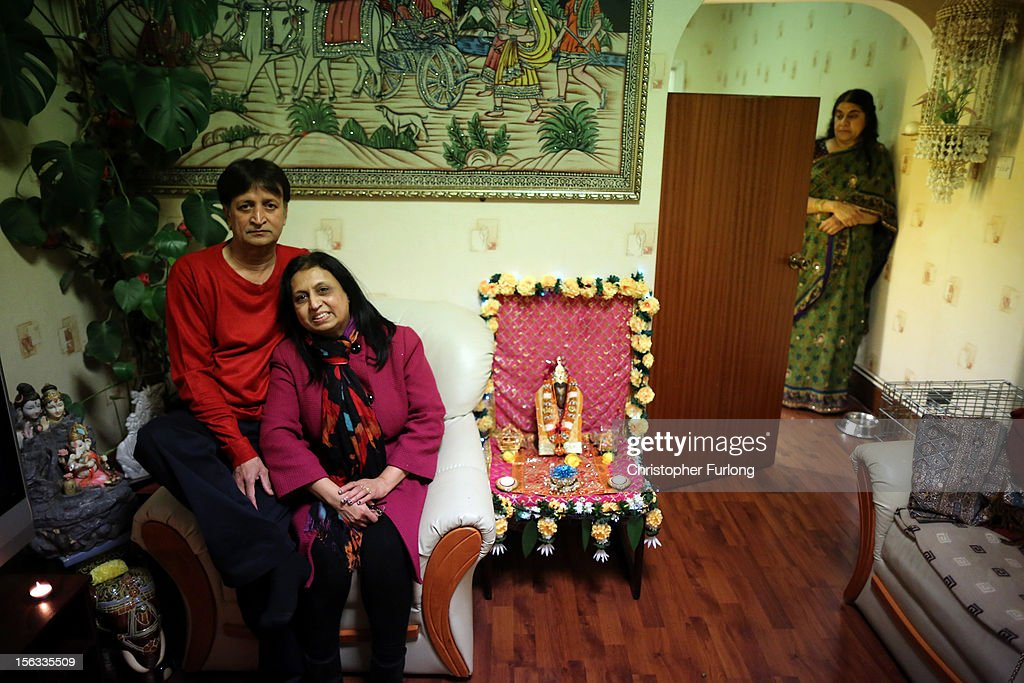 Residents Suresh Bakrania and his wife Hansa (C) pose as they sit inside their home which is decorated to celebrate the Hindu festival of Diwali on November 13, 2012 in Leicester, United Kingdom. Up to 35,000 people attended the Diwali festival of light in Leicester's Golden Mile in the heart of the city's asian community. The festival is an opportunity for Hindus to honour Lakshmi, the goddess of wealth and other gods. Leicester's celebrations are one of the biggest in the world outside India. Sikhs and Jains also celebrate Diwali.