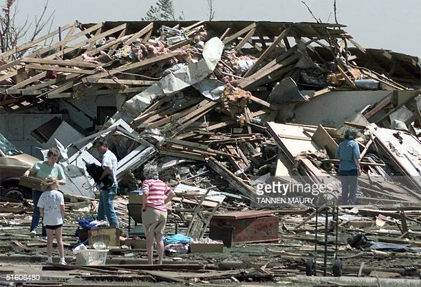 Residents survey their tornadoravaged homes 04 May 1999 in Moore Oklahoma At least 36 have died in Oklahoma and Kansas after 13 tornados ripped...