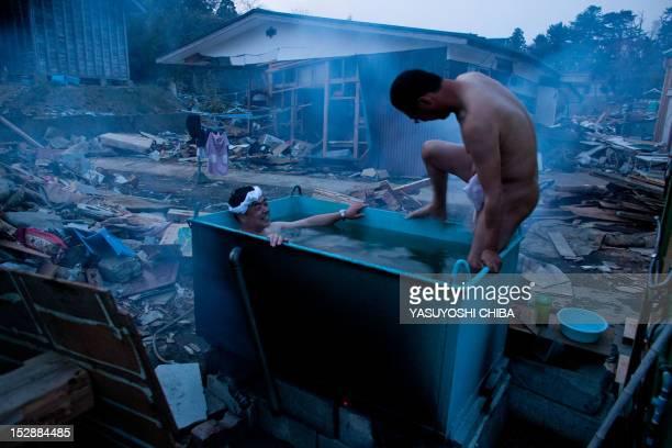 TOWN Residents take an out door bath amongst tsunami devastation in Minamisanriku town Miyagi prefecture on April 14 2011 Japan's seismologists were...