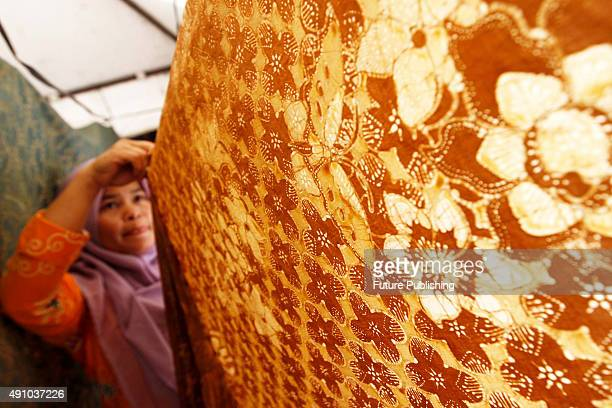 Residents take part in activities marking National Batik Day 2015 at Tebet village on October 2 2015 in Jakarta Indonesia 'Batik' is a traditional...