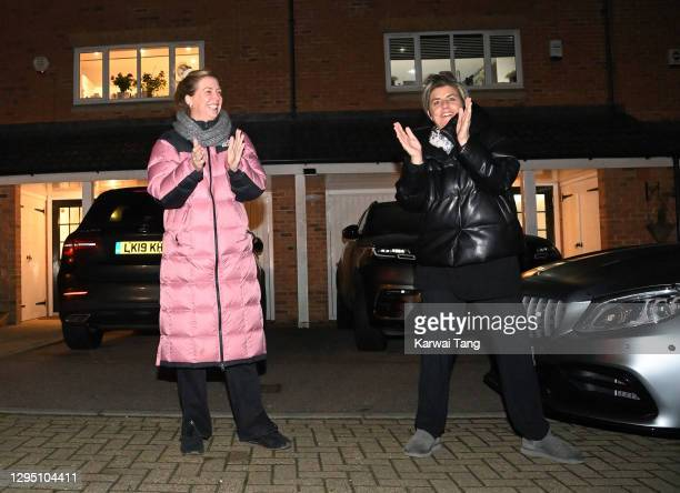 """Residents take part in """"Clap for Heroes"""" on January 07, 2021 in Borehamwood, England. During the first Coronavirus pandemic lockdown, beginning in..."""