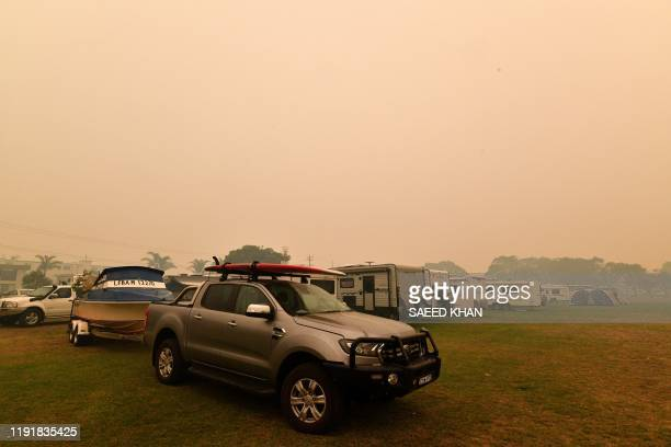 Residents take refuge from bushfires at a beach in Merimbula in Australia's New South Wales state on January 5 2020 Australians on January 5 counted...