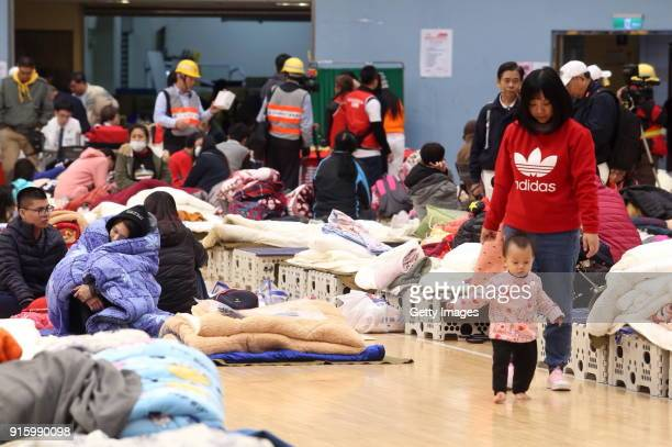 Residents take shelter at a local stadium on February 8, 2018 in Hualien, Taiwan. The death toll from the 6.5-magnitude earthquake in Hualien county...