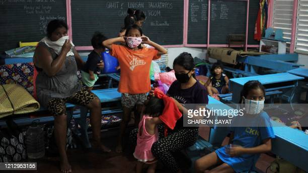 Residents take shelter at a school building serving as evacuation center in Sorsogon town Bicol region south of Manila on May 14 as Typhoon Vongfong...