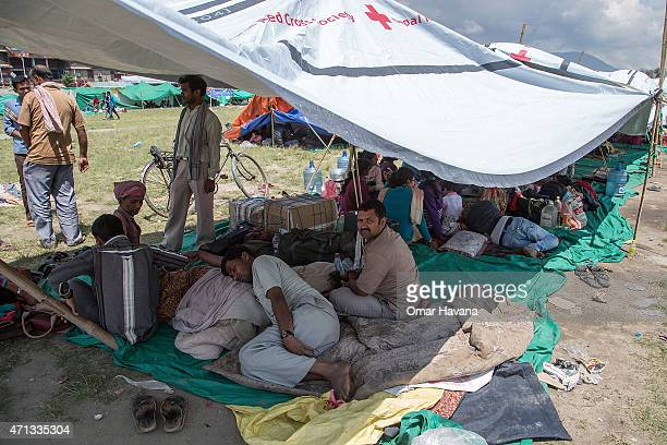 Residents take shelter in an evacuation area set up by the authorities in Tundhikel park on April 27 2015 in Kathmandu Nepal A major 78 earthquake...