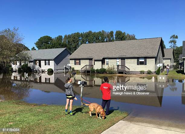 Residents talk across the water on Wednesday Oct 12 2016 at the Wyndham Circle duplex complex in Greenville NC The homes were threatened as the Tar...