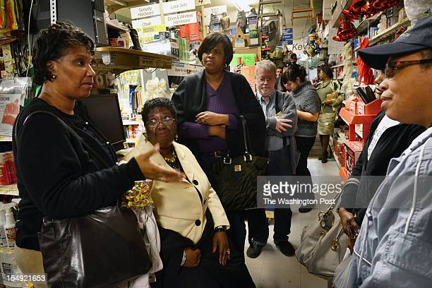 Residents talk as they wait at Brookland hardware for a shipment of batteries in advance of a possible historic storm on October 2012 in Washington,...