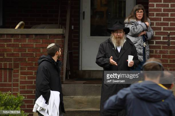 Residents talk to the media near the site of a mass shooting at the Tree of Life Synagogue in the Squirrel Hill neighborhood on October 27 2018 in...