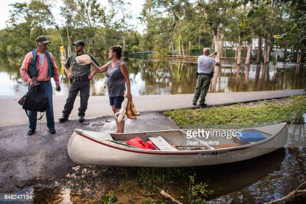 Residents talk with law enforcement after flood waters caused by Hurricane Irma inundated their neighborhood September 12, 2017 in Middleburg,...