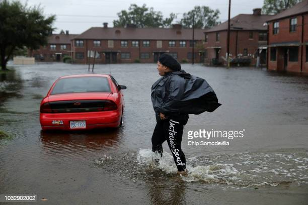 Residents try to prepare for more floodwaters at the Trent Court public housing apartments after the Neuse River went over its banks during Hurricane...