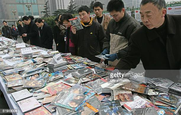Residents view illegally made discs before the material is destroyed January 12 2005 in Chengdu China China has launched large campaigns to crack...
