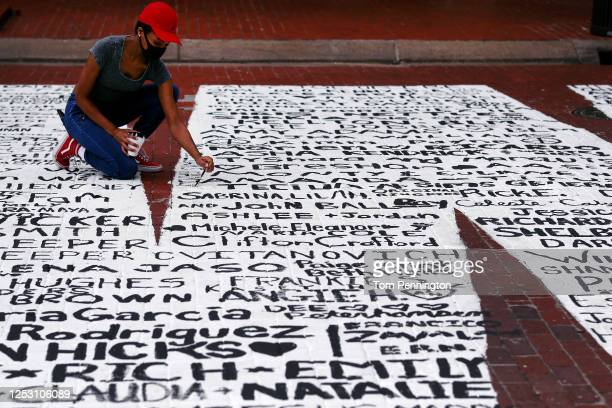 Residents view the End Racism Now mural painted on Main Street in downtown on June 28 2020 in Fort Worth Texas Local artists partnered with...