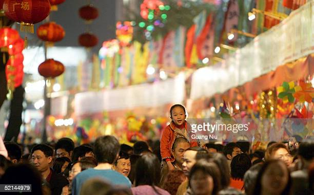Residents visit a night market to mark the Chinese New Year February 7, 2005 in Guangzhou, Guangdong province, China. People start to celebrate the...