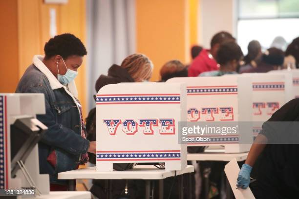 Residents vote at a polling place in the Midtown neighborhood on October 20, 2020 in Milwaukee, Wisconsin. Today is the first day of early voting in...