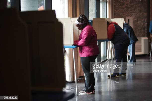 Residents vote at a polling place set up for early voting on November 01, 2020 in Racine, Wisconsin. Today is the final day for early voting in the...
