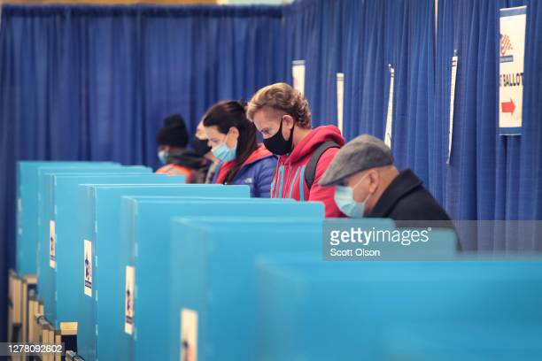Residents vote at an early voting site on October 02, 2020 in Chicago, Illinois. The city opened its first early voting site in the Loop yesterday...