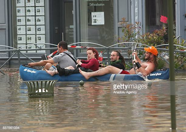 Residents wade through a flooded street in Nemours southeast of Paris on June 1 2016 Torrential rain has continued to lash northern and centra France