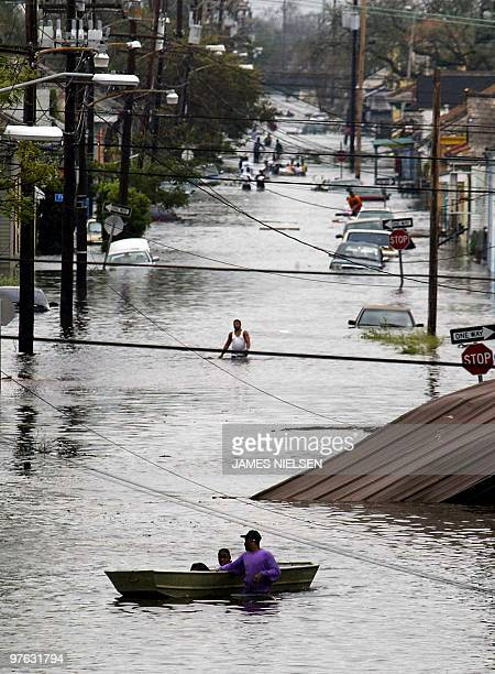 Residents wade through a flooded street in New Orleans 29 August 2005 after hurricane Katrina made landfall Hurricane Katrina made landfall early...
