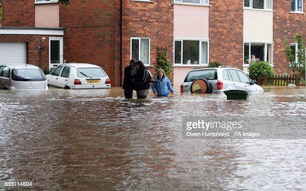 Residents wade through a waterfilled street in Beverley North East Yorkshire after heavy rainfall caused flooding