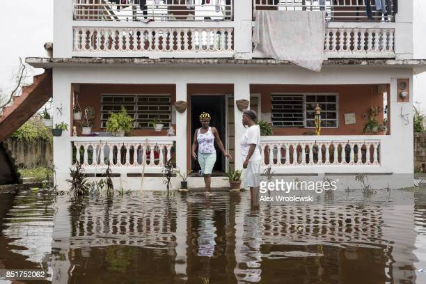 Residents wade through flood waters at their home days after Hurricane Maria made landfall on September 22 2017 in Loiza Puerto Rico Many on the...