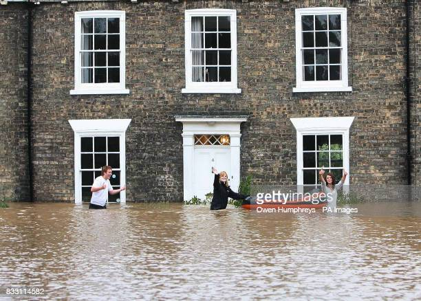 Residents wade through water in Beverley North East Yorkshire after heavy rainfall caused flooding