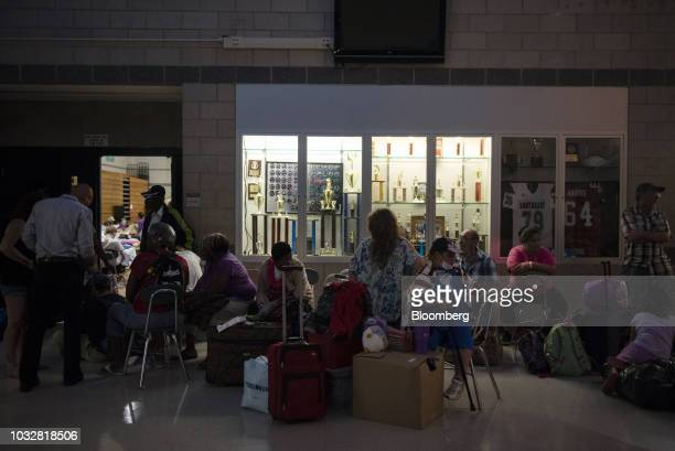 Residents wait for an empty cot at an evacuation shelter ahead of Hurricane Florence at the Southeast Raleigh High School in Raleigh North Carolina...