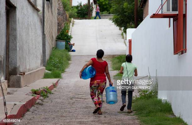 Residents wait for drinking water in the Arizpe community Sonora state Mexico on August 12 where five days ago a copper mine leaked 40 thousand cubic...