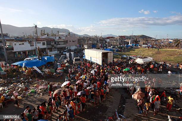 Residents wait for their turn to get relief supplies in Tacloban Hospital on November 15 2013 in Tacloban Philippines Typhoon Haiyan which ripped...