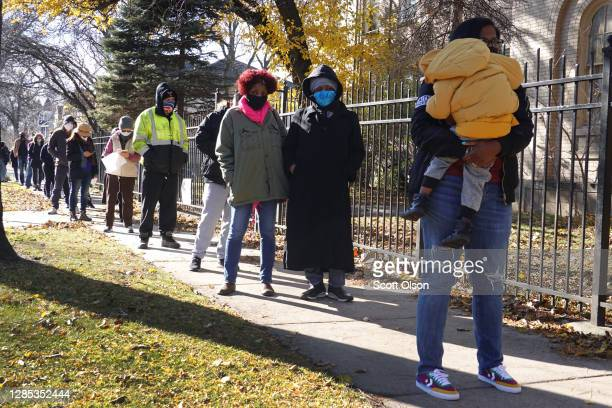 Residents wait in line for COVID-19 tests at a test site run by CORE at St. Benedict the African Catholic Church in the Englewood neighborhood on...