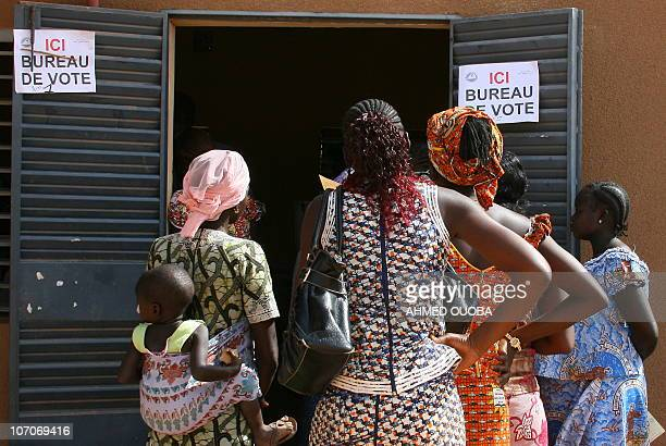 Residents wait in line to cast their votes on November 21 2010 at the polling station in Ouagadougou to vote in the first round of presidential...