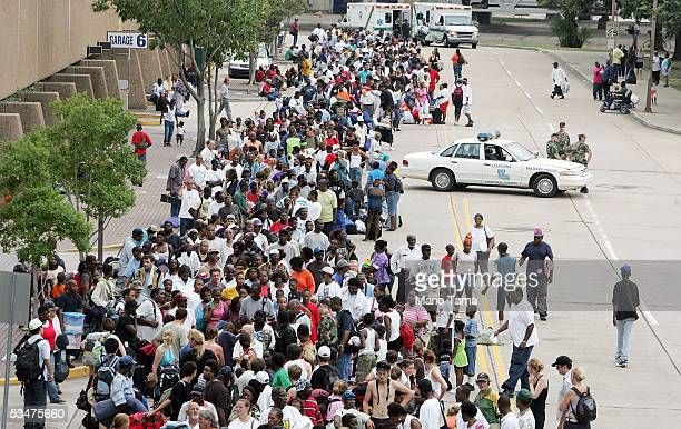 Residents wait in line to enter the Superdome which is being used as an emergency shelter before the arrival of Hurricane Katrina August 28, 2005 in...