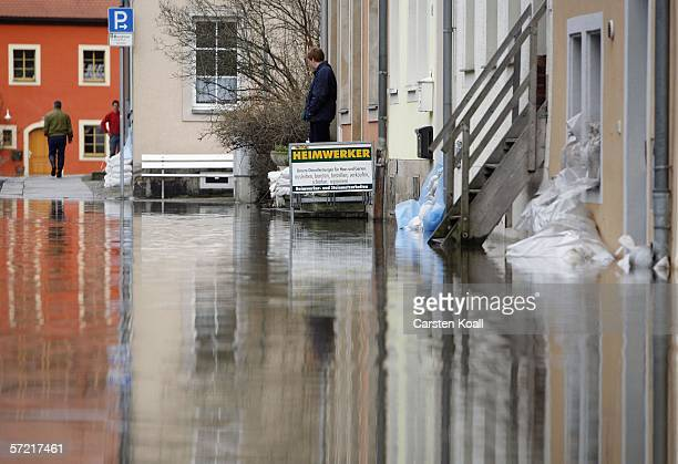 Residents wait in the flooded streets of the eastern German city of Pirna next to the river Elbe on March 30 2006 about 20 kilometers east of Dresden...