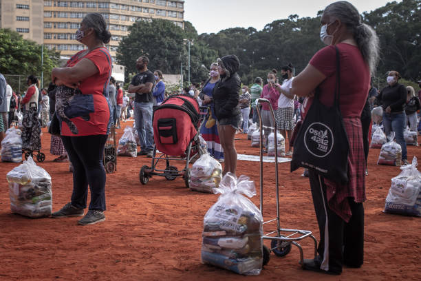 BRA: Food Distribution At Heliopolis Favela As Nearly Half Of Population Faces Food Insecurity