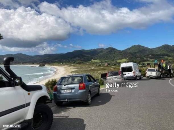 Residents wait on higher ground following a tsunami warning on March 5, 2021 in Great Barrier Island, New Zealand. A number of low-lying coastal...