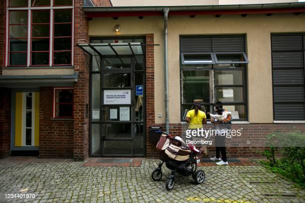 Residents wait outside the rental office on the Carl Legien modernist housing estate, operated by Deutsche Wohnen SE, in Berlin, Germany, on Monday,...