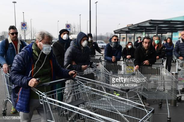 Residents wait to be given access to shop in a supermarket in small groups of forty people on February 23, 2020 in the small Italian town of...