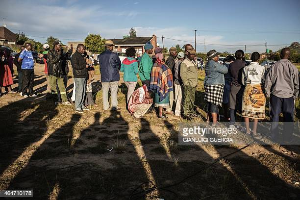 Residents wait to cast their ballot for the parliamentary elections at a voting station on the outskirts of Maseru on February 28, 2015. A snap...