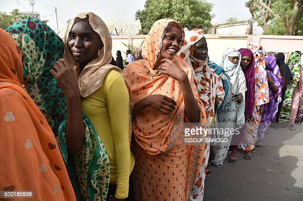 Residents wait to cast their vote at a polling station in N'djamena for the presidential election on April 10 2016 A total of 13 candidates are...