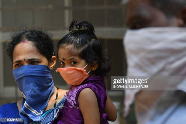 Residents wait to get tested for the the COVID19 coronavirus inside Dharavi slums during a governmentimposed nationwide lockdown as a preventive...