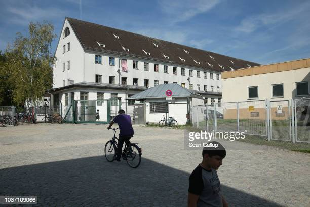 Residents stand outside one of Bavaria's newlyintroduced 'anchor centers' for asylum applicants on September 21 2018 in Deggendorf Germany According...