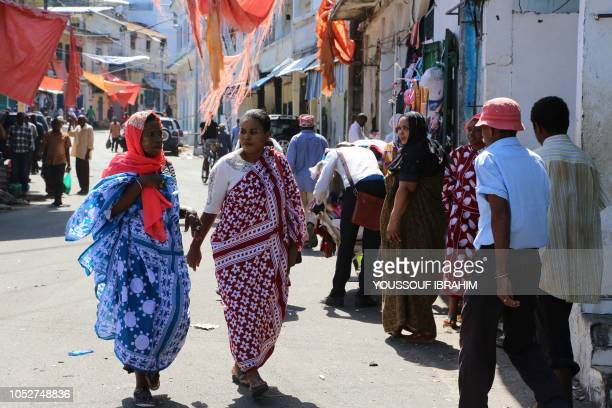 Residents walk and shop by the main streets of Mutsamudu on the Comoros island of Anjouan on October 22 2018 Residents on the Comoros island of...