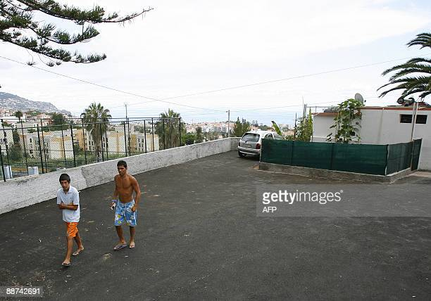 Residents walk at the site where Portuguese footballer Cristiano Ronaldo was born at Bairro Quinta Falcao in Funchal Madeira Island on June 24 2009...