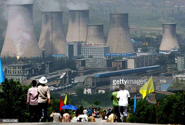 Residents walk down a road that leads to the county's power plant in Zhangjiakou northeast China's Hebei province 19 June 2005 A top Chinese...