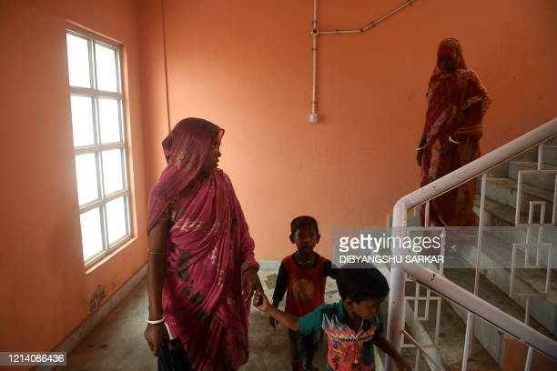 Residents walk down stairs at a shelter ahead of the expected landfall of cyclone Amphan in Tajpur of East Midnapore district in West Bengal on May...